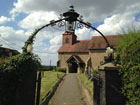 The church gate fixed with flowers from a recent wedding